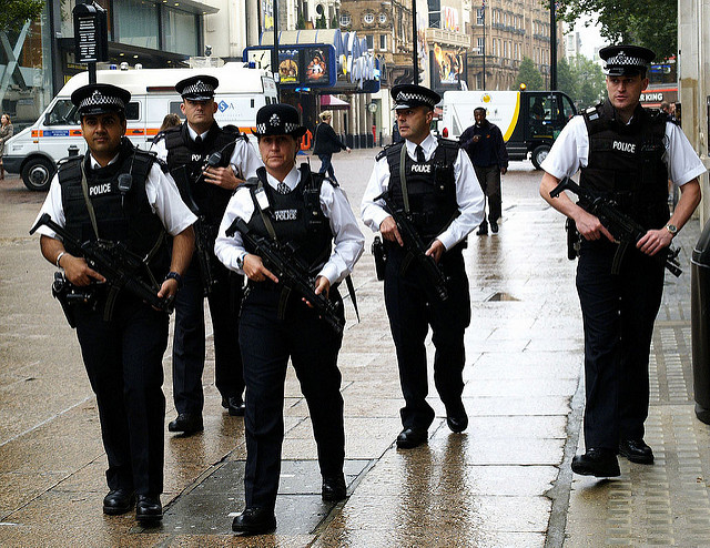 British armed police patrol London's Leicester Square in July 2005, following the suicide bombings on the London transport system. The photo, widely published, was transmitted into the Associated Press World wide network directly from a pda using Phojo, from a nearby wifi point.This copy was sent into the Idruna FTP, via Phojo, at the same compression as the original transmission.photo by max nash