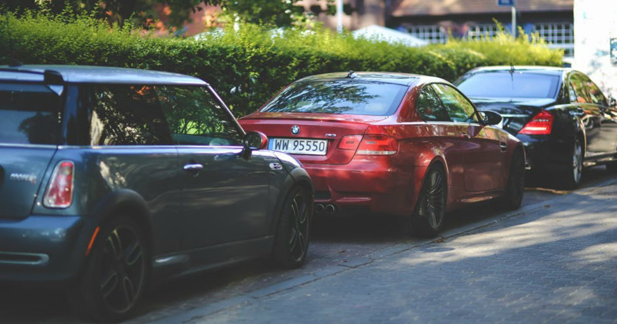 https://www.pexels.com/photo/cars-parked-along-way-6147/