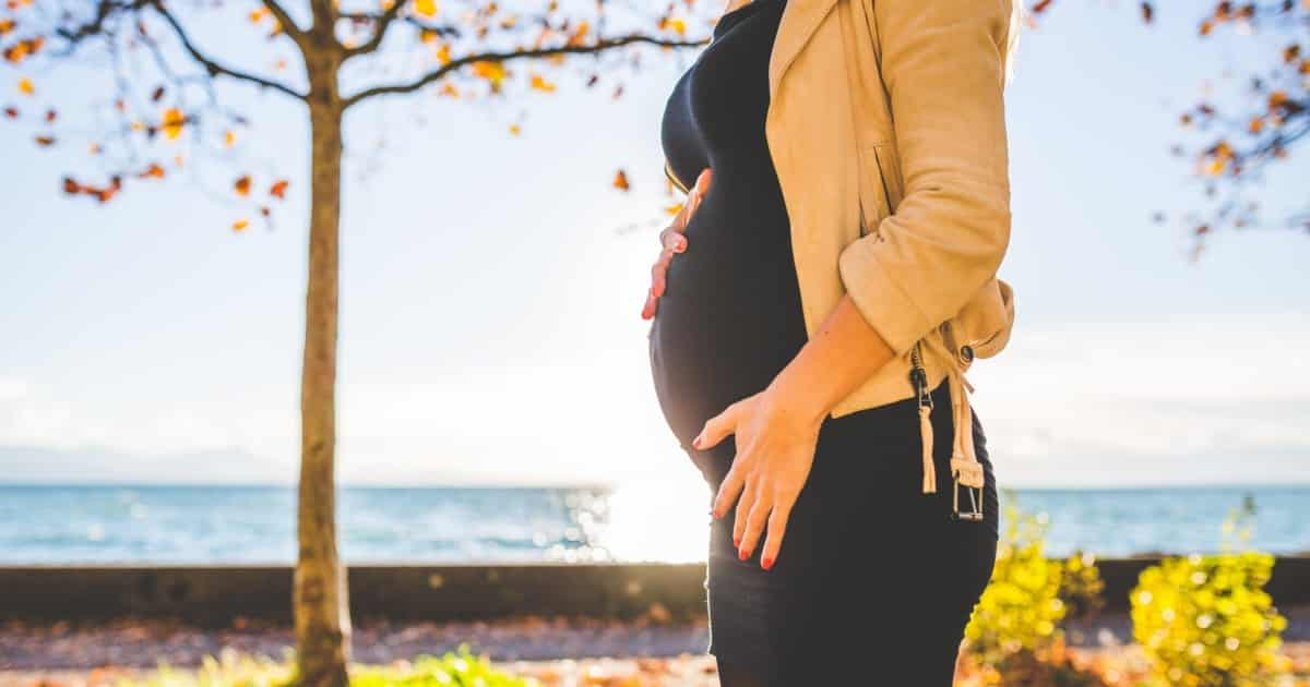 https://www.pexels.com/photo/pregnant-woman-wearing-beige-long-sleeve-shirt-standing-near-brown-tree-at-daytime-132730/