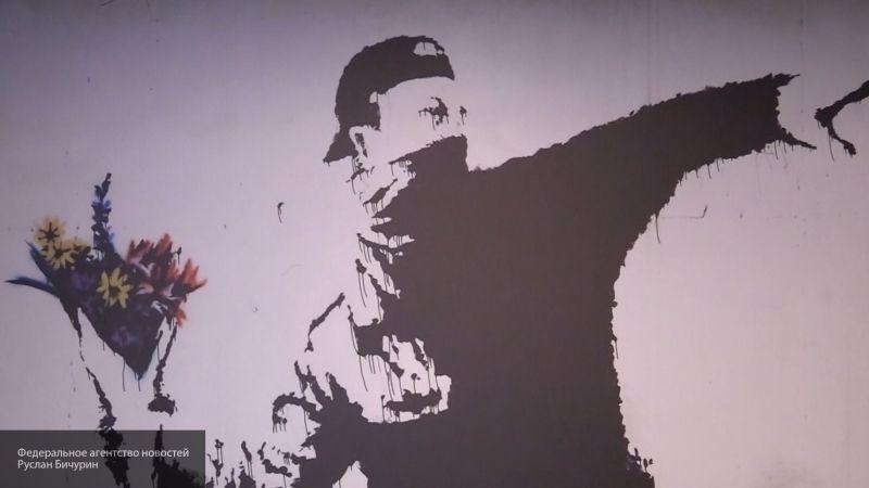 Посвященное Brexit граффити уличного художника Бэнкси закрашено краской в Великобритании