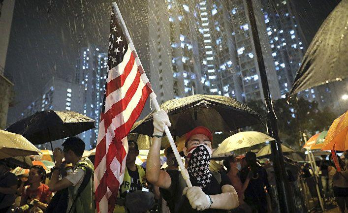 Общество: Жэньминь жибао (Китай): насильственные действия в Сянгане нанесли ответный удар по Западу