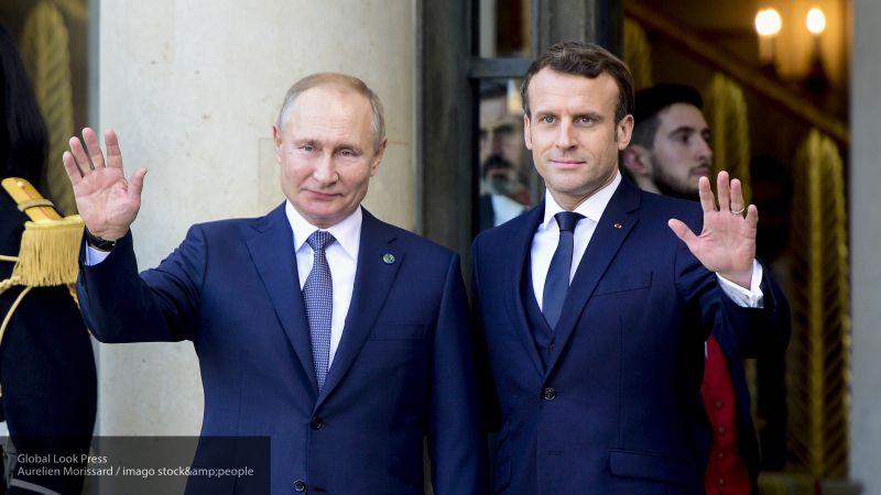 Путин и Макрон договорились сохранить иранскую ядерную сделку